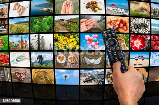 1032516726 istock photo Big multimedia broadcast video wall with remote control 656926596
