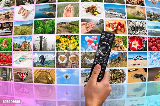1032516726 istock photo Big multimedia broadcast video wall with remote control 656926688