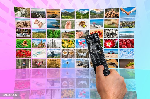 1032516726 istock photo Big multimedia broadcast video wall with remote control 656929664