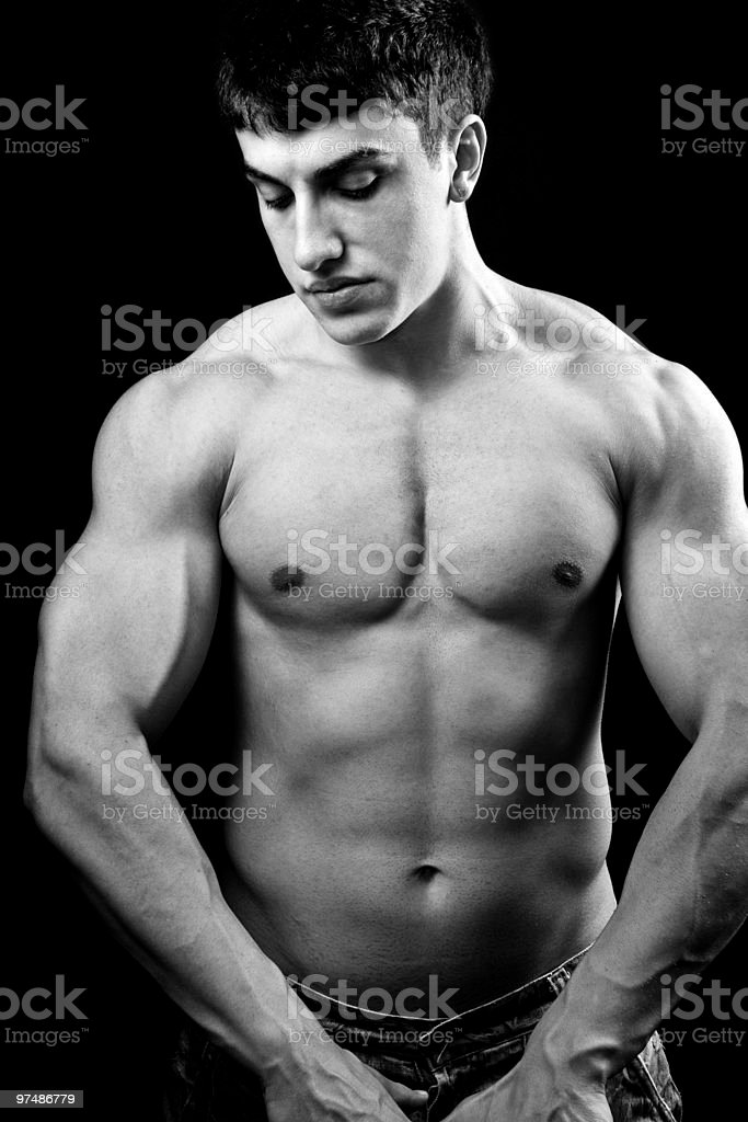 Big muscular sexy young bodybuilder royalty-free stock photo