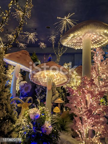 Close up of big mushrooms and christmas decorations and lights