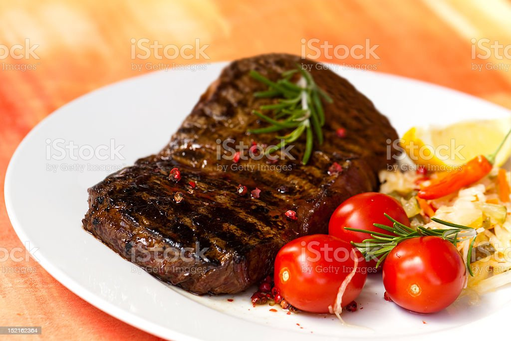 XXL , big new york strip steak,grilled,with salad royalty-free stock photo