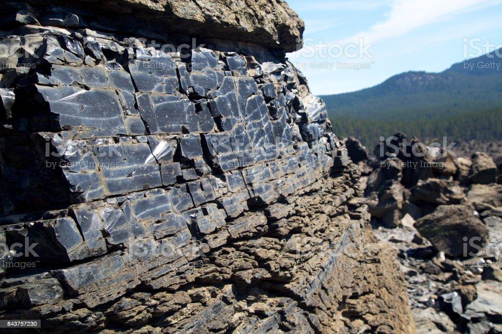 Big obsidian flow -Black obsidian near Paulina Lake in Central Oregon's Newberry Caldera stock photo