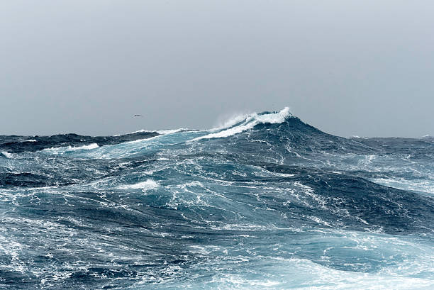 big ocean swells in a stormy sea - rough stock photos and pictures