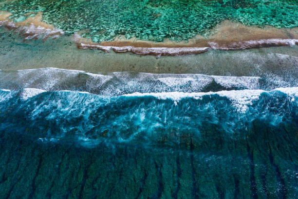 Big ocean waves hitting a coral rif. View from above. stock photo