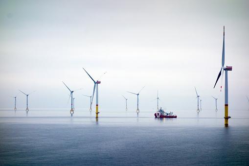 Wind-turbine, offshore, worker, boat, sea, sun, vessel