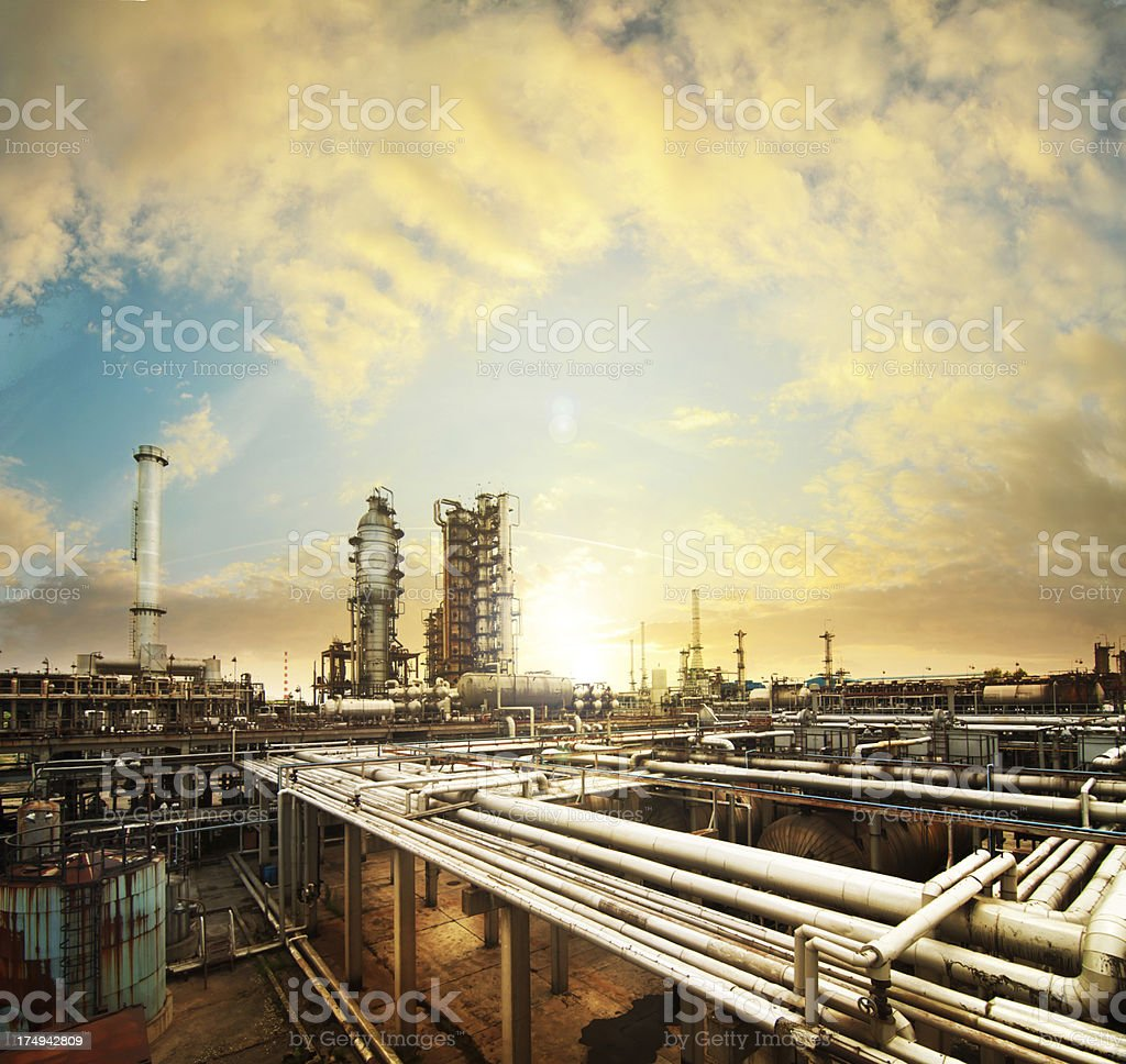 Big oil refinery in a sunset stock photo