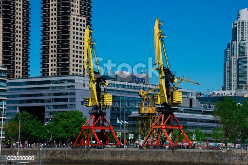 Buenos Aires, Argentina. October 15, 2018. Big old cranes in Puerto Madero neighborhood waterfront, the newest barrio (district) of Buenos Aires