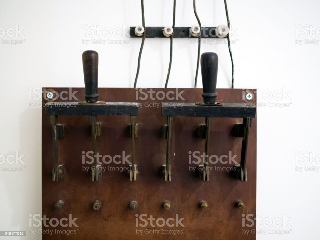 Big old electric knife switch for manual connection of consumers stock photo