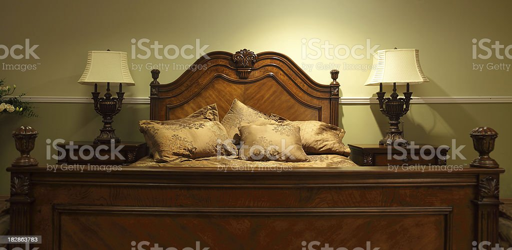 Big old fashioned bed stock photo