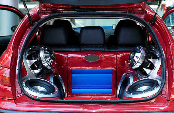 Big ones Hi-fi music big loudspeakers installed in a car's trunk. stereo stock pictures, royalty-free photos & images