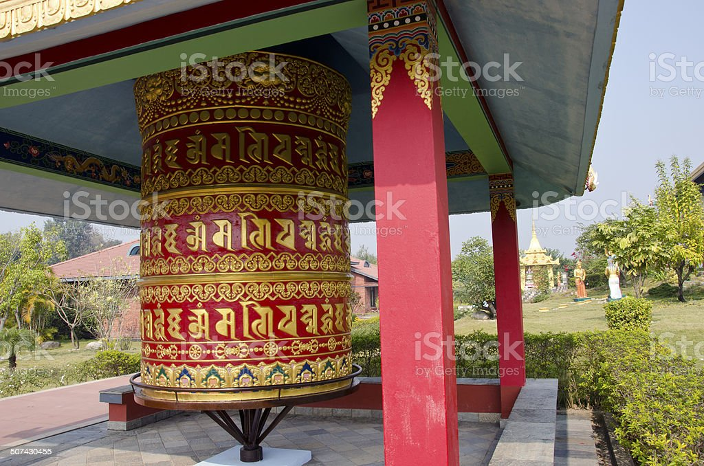 big ornate buddhists prayer wheel in Lumbini, Nepal stock photo