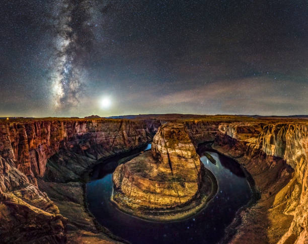 big panorama of Horseshoe Bend at night with Milky way and moon. Arizona candid photo of Horseshoe Bend at night with milky way and moon in the sky. Arizona. USA horseshoe bend colorado river stock pictures, royalty-free photos & images