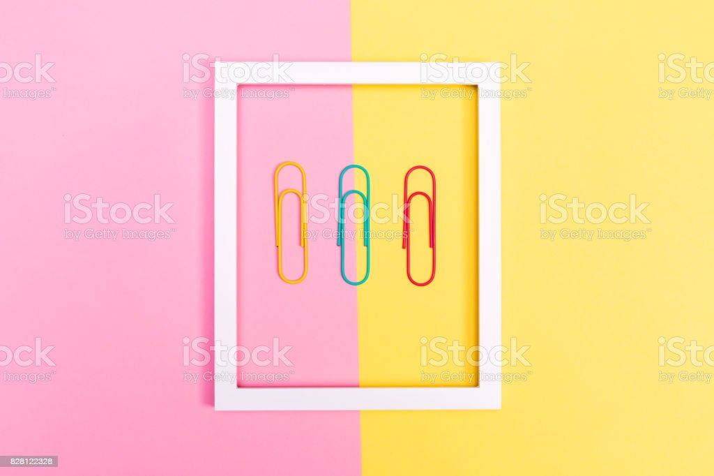 Big paper clips on a vibrant background stock photo