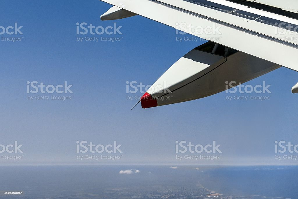 Big passenger jet airplane gaining altitude after taking off stock photo