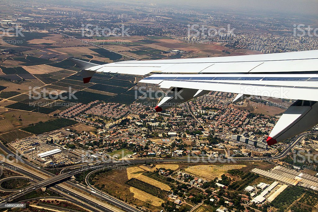 Big passenger jet airplane over Tel Aviv environs stock photo