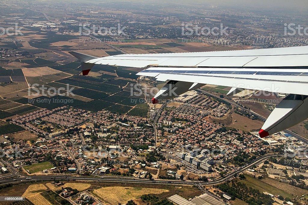 Big passenger jet airplane over Tel Aviv environs stock photo