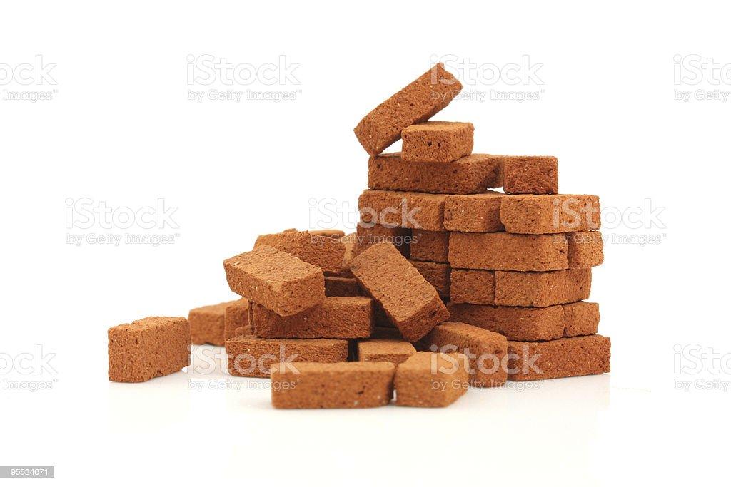 Big pile of bricks isolated stock photo
