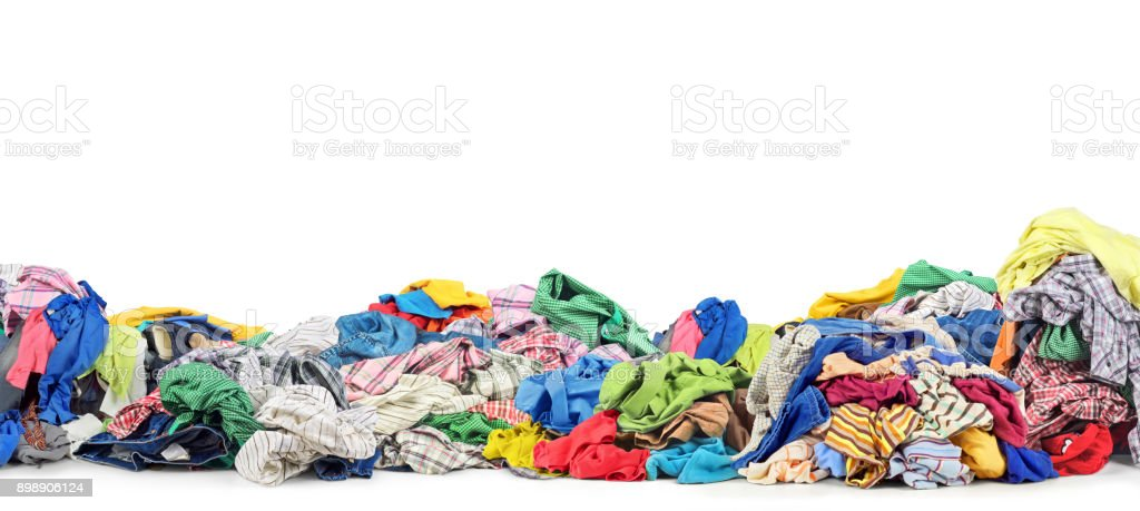 Big pile of clothes on a white background stock photo