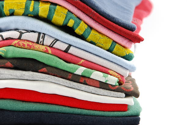 A big pile of colorful t-shirts stock photo