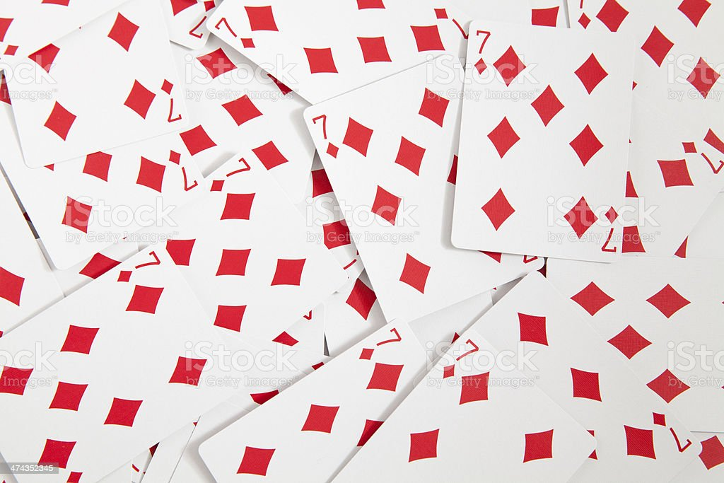 Big pile of diamond seven poker cards background stock photo
