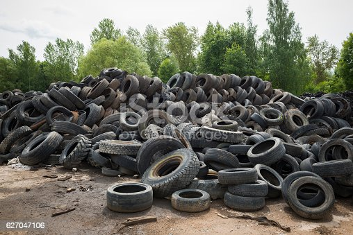A large pile of old tires, representing a variety of brands, at Raadi Airfield in Tartu, Estonia. The airfield was once a major Soviet air force base.