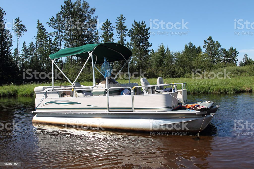 Big pontoon boat anchored in the river stock photo