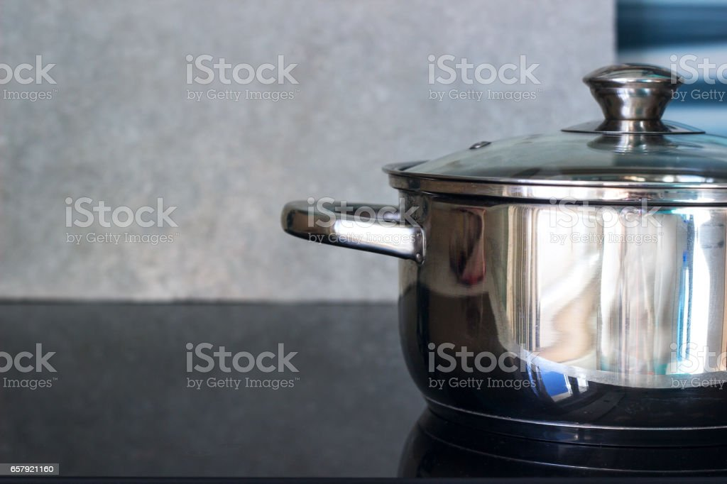 Big pot in modern kitchen with induction stove stock photo