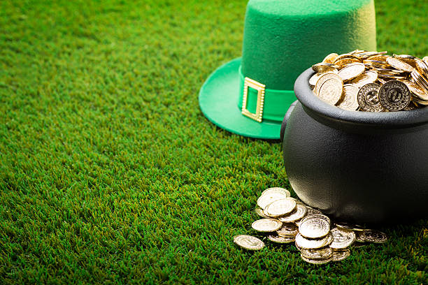 big pot of gold and hat on st. patrick's day - st patricks day stock photos and pictures