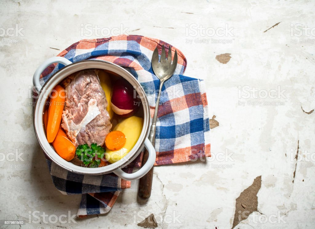 big pot of soup with meat and fresh vegetables. stock photo