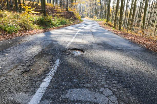 Big pothole on open road