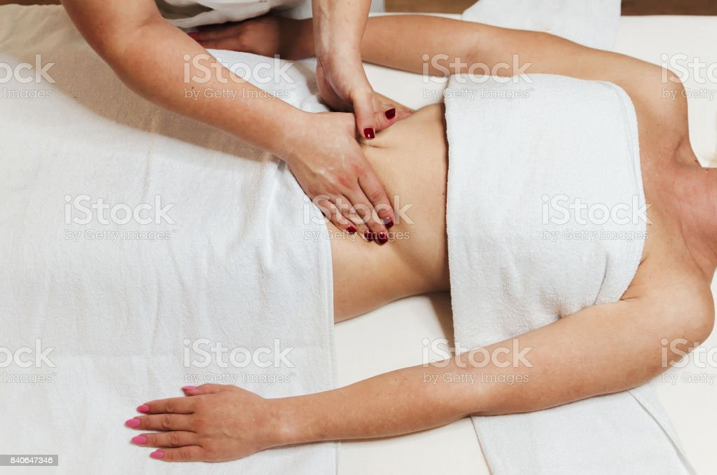 Big pressure on the stomach in spa stock photo