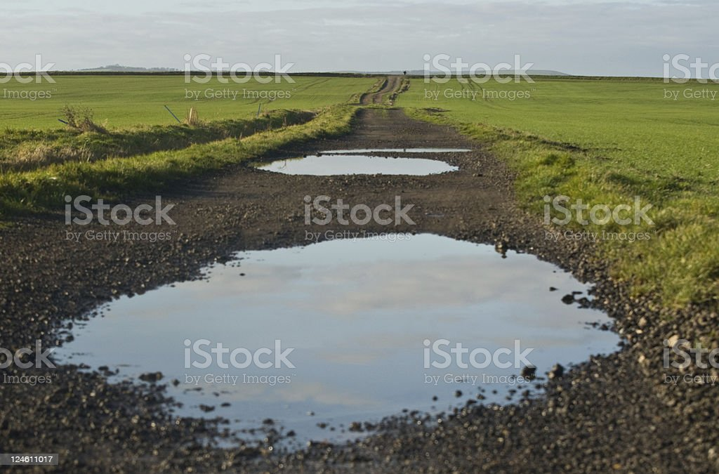Big puddle in the road stock photo
