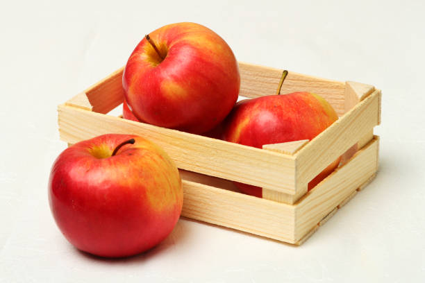 Cтоковое фото Big red apples in wooden box.