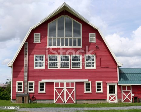 A big red barn used as a yoga studio.