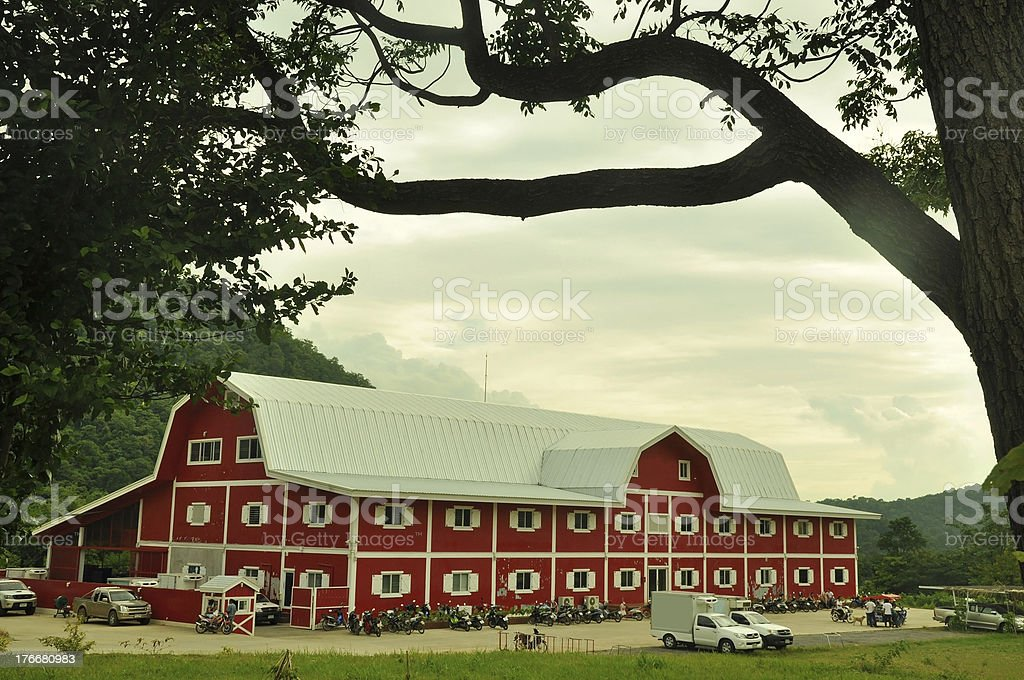 big red barn with mountain royalty-free stock photo