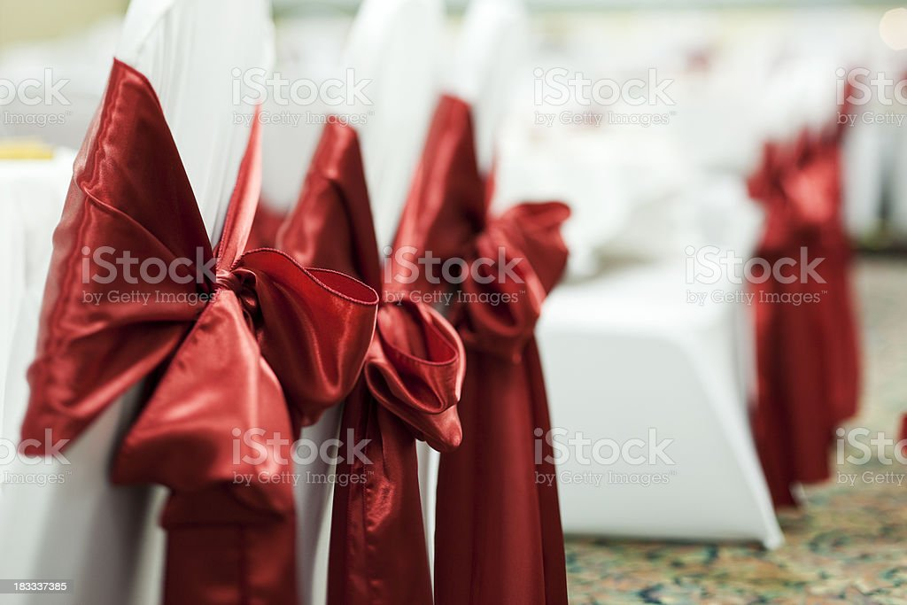 Big Red Bows on Wedding Chairs, Copy Space royalty-free stock photo