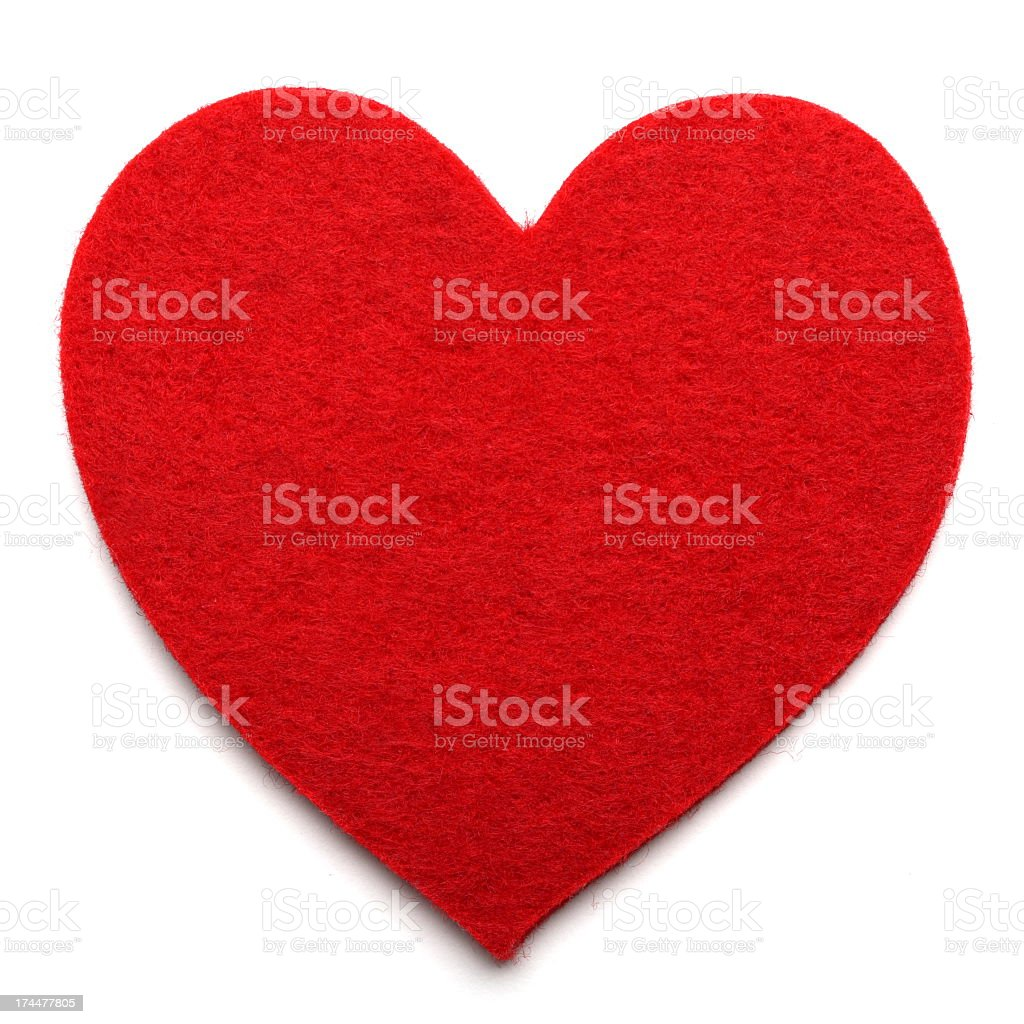 Big red felt heart on a white background stock photo