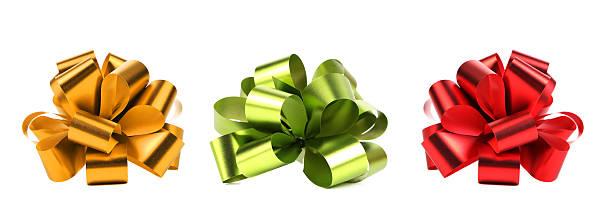 big red grünen und gelben schleifen. - geschenkschleife stock-fotos und bilder