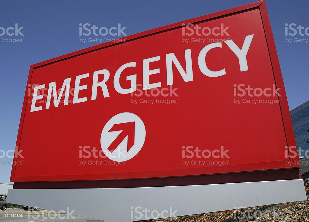 Big Red Hospital Emergency Sign with Arrow royalty-free stock photo
