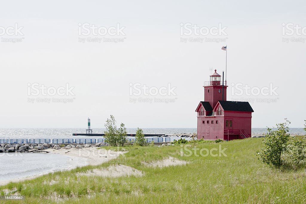 Big Red Lighhouse by Sea stock photo
