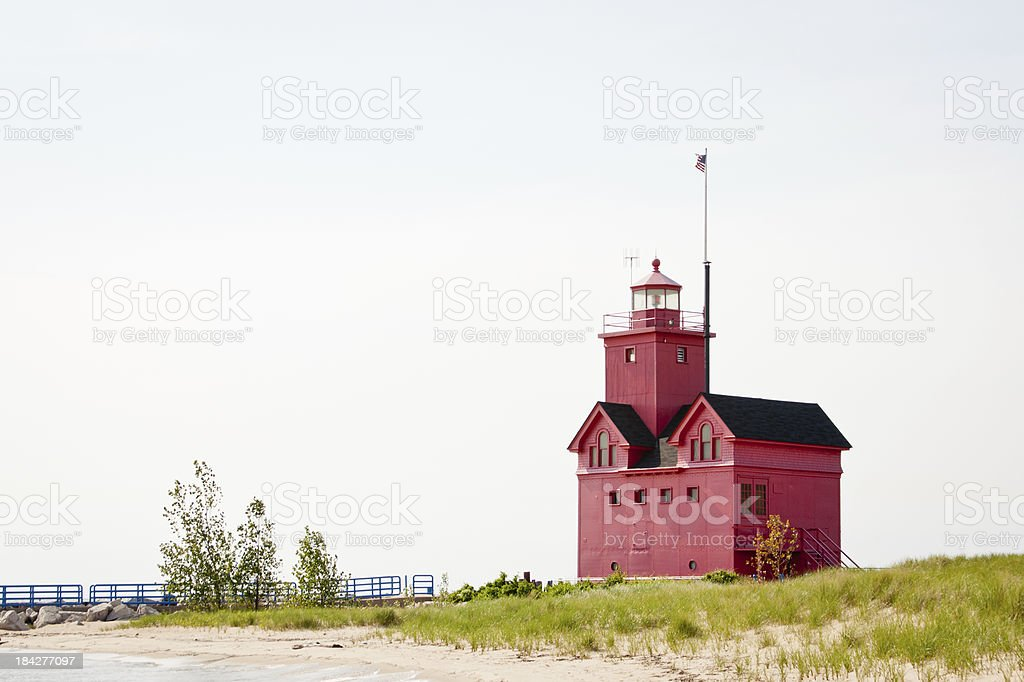 Big Red Lighthouse on Beach stock photo