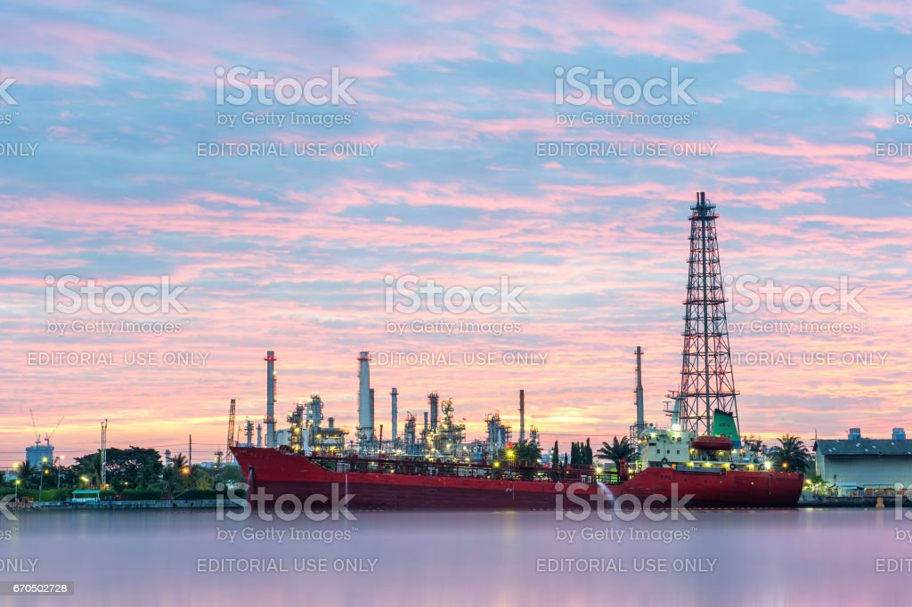 Big red ship infront of Oil refinery factory at dawn, Bangchak Oil...