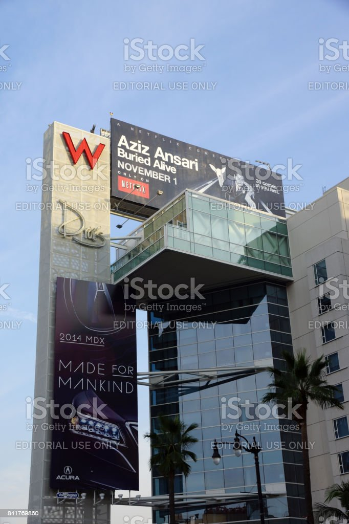 Big Red W and Drais signs with ads for Aziz Ansariand Acura on the side of the Modern W Hotel Hollywood building stock photo