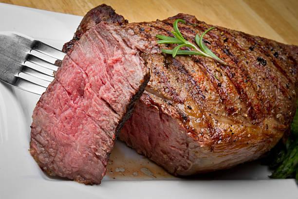 big rib eye beef steak with bite cut out - ribeye biefstuk stockfoto's en -beelden