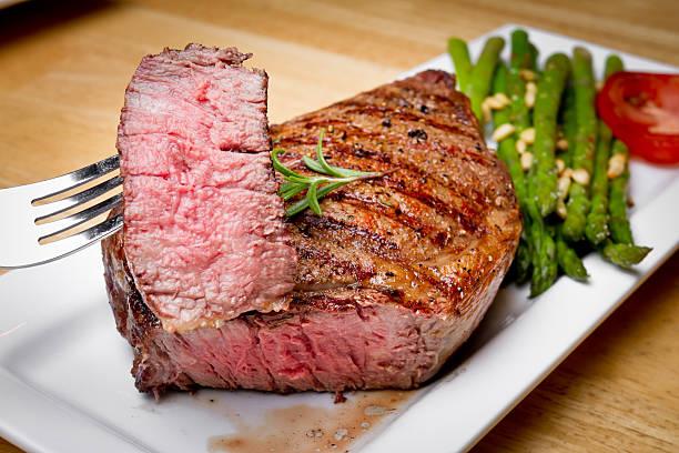 big rib eye steak with bite cut out - ribeye biefstuk stockfoto's en -beelden
