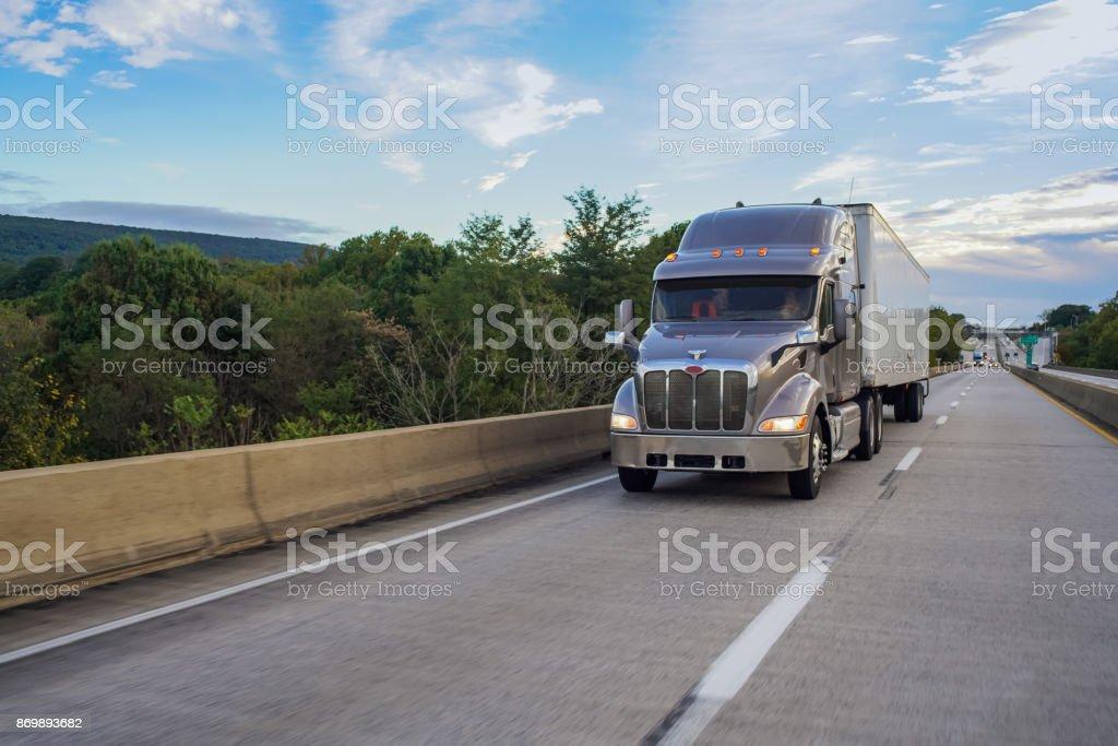 Big rig 18 wheeler truck on road stock photo