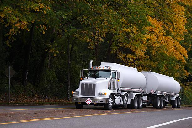 big rig semi truck two tank trailers on autumn road - aufgemotzte trucks stock-fotos und bilder