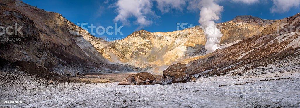 Big rocks on the eternal snow inside Mutnovsky volcano crater stock photo
