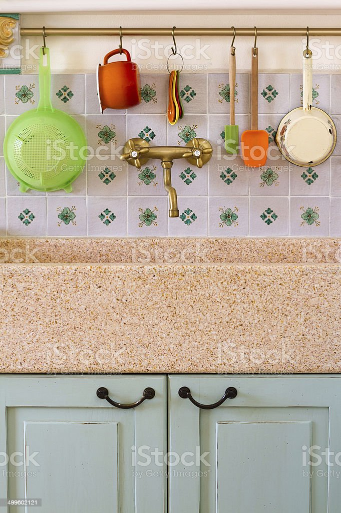 Big Rustic Kitchen Sink With Italian Tile Backsplash Stock Photo